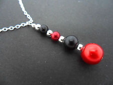 A RED & BLACK GLASS PEARL  SILVER PLATED PENDANT NECKLACE. NEW.