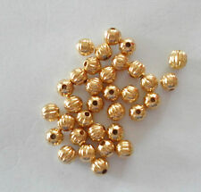 WHOLESALE METAL BEADS; 4mm Gold-plated, corrugated design , pack of 50   #135
