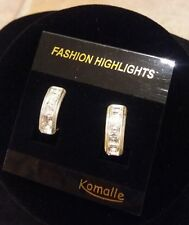 Clip on earrings with silver crystals and gold edgings