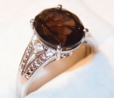 Brazilian Smoky Quartz and Diamond ring (4.010ct) in platinum bond, Size S.