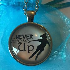 Peter Pan. Never Grow Up Glass Cabochon Dome Pendant Necklace. Silver Plated.
