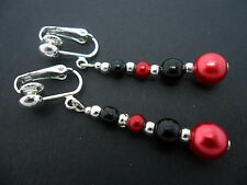 A PAIR OF DANGLY RED & BLACK GLASS PEARL  SILVER PLATED CLIP ON   EARRINGS.