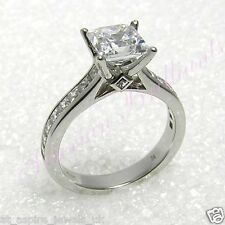 14C WHITE GOLD WITH CHANNEL SET PRINCESS CUT SOLITAIRE ENGAGEMENT RING IN 2.09CT