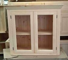 Solid pine kitchen wall cabinet with glazed doors