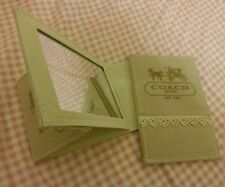 a Coach Canvas 2 Fold Pocket Mirror from Japan's Magazine