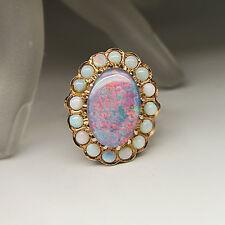 Ring mit einer Opal Doublette und 16 Opale in 585/14K Rotgold