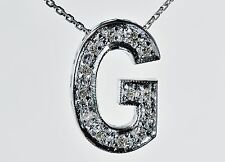 WHITE GOLD DIAMOND NECKLACE. INITIAL G IN 18 CT & 13 DIAMONDS ON A 42 CM CHAIN.
