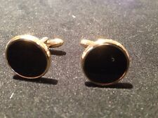 gold cufflinks with black agate