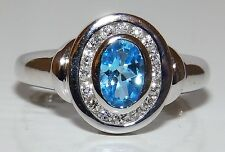 A FINE  9CT WHITE GOLD AQUA BLUE TOPAZ 0.16CT DIAMOND KATE CLUSTER RING SIZE  J
