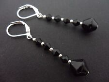 A PAIR OF DANGLY BLACK GLASS CRYSTAL SILVER PLATED LEVERBACK  EARRINGS.