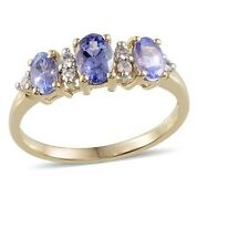 "Tanzanite & White Sapphire 9k Yellow Gold ""Trilogy Band"" Ring."