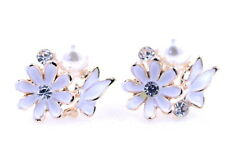 Gold tone enamel white daisy and butterfly stud earrings with crystal