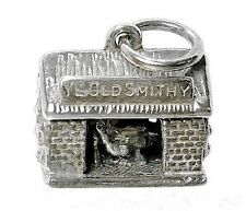VINTAGE SILVER MOVING BLACKSMITH CHARM