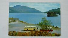 LOCH LOMAND WITH TOURIST COACHES PARKED IN THE FOREGROUND
