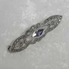 Sterling Silver Marcasite brooch with purple crystal