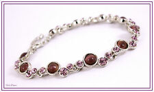 MAJIQUE LONDON. VERY PRETTY SILVER BRACELET WITH PURPLE TONE CRYSTALS.