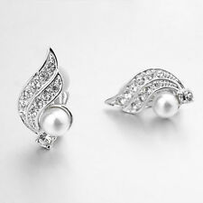 18K WHITE GOLD PLATED CLEAR GENUINE SWAROVSKI CRYSTAL CLIP-ON EARRINGS