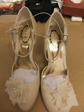 "Ivory satin shoes by Debut with ankle strap and flower/pearl detail.S7.Heel 4""."