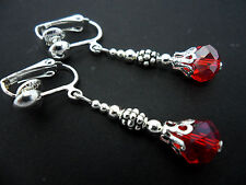 A PAIR OF SILVER PLATED RED CRYSTAL   BEAD CLIP ON EARRINGS. NEW.