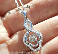 """Diamonds """"IN MOTION"""" Round cut Sterling Silver Dancing Rhythm Pendant Necklace"""