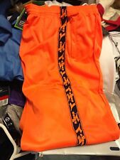 DIADORA TRAKSUITS BOTTOMS POLYESTERIN 24 26 28  AT £8 ORANGE