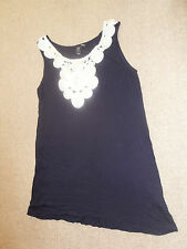 H&M sleevless top with ribbon swirls detail at neckline- size M