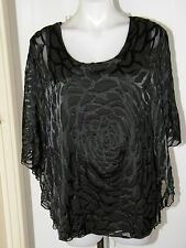 From Myers Autograph Ladies batwing sleeve top size 14 RRP$79.95 really an 18