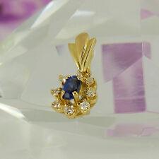 Anhänger in 750/- Gelbgold mit 1 Saphir + 8 Diamanten