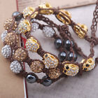 white light colorado crystal pave ball bead gold tone skull wax cord bracelet