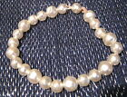 Lovely simple elasticated string of faux pearl bead on a bracelet naive but nice