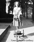 Girl Riding a 3-Wheeled Scooter with Steering Wheel -c1920- Historic Photo Print
