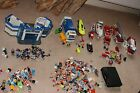 Large playmobil bundle: fire engine, police station, 30+ figures, carrycase, etc