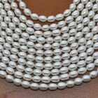 Stunning wholesale natural real pearl strands rice shape 4-5mm beads Q30207