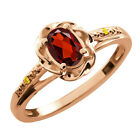0.56 Ct Oval Red Garnet Canary Diamond Rose Gold Plated Sterling Silver Ring