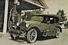 Vintage black and white snapshot photo, 2 men old car gas station 1930's or 40's
