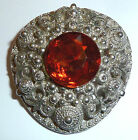 A VINTAGE 1980s SILVER TONE SCARF CLIP WITH ORANGE GLASS STONE