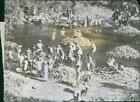 People taking water in the river during the Western imperialism in Asia. - Vinta