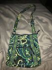 blue green and white vera bradley satchel with adjustable satch. Many pockets.