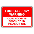 Our Food Is Cooked in Peanut Oil Aluminum Metal Sign