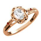 0.57 Ct Oval White Topaz Red Garnet Rose Gold Plated Sterling Silver Ring