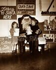 VERY OLD SANTA CLAUS AT THE CHRISTMAS TOY STORE PHOTO