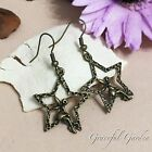 ER2950 Graceful Garden Bronze Tone Fairy Sitting on Star Charm Dangle Earrings
