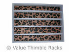 50 thimble display rack in white with a cheetah  themed felt back/animal print