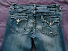 Vigoss Jeans size 11 skinny, button flap pockets factory distressed stretch