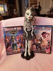 2 Monster High DVD's & 1 Monste High Doll With Stand