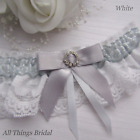 Bridal Garter. White or Ivory Lace with silver satin trim & Diamante buckle.