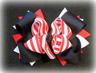 Preppy Stripes Red White Black Boutique Hair Bow 3 layers of Loops Spikes Funky