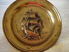 Set of Two 20 inch Brass Plates with Ship carvings shows some age.