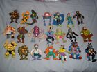 21 TEENAGE MUTANT NINA TURTLES ACTION FIGURES AND COLLECTORS CASE