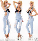SEXY WOMEN'S LIGHT BLUE DENIM DUNGAREES BIB JEANS IN DESTROYED LOOK.